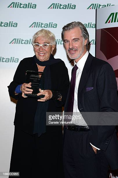 Lina Wertmuller and Carlo Pittis attend the Jet Set Party Alitalia at Residenza di Ripetta on November 10 2012 in Rome Italy