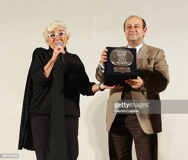 Lina Wertmuller receives Mediterranea Award by Giuseppe Sidari municipal councilor at Cinema Odoen during Reggio Calabria FilmFest on February 3 2010...