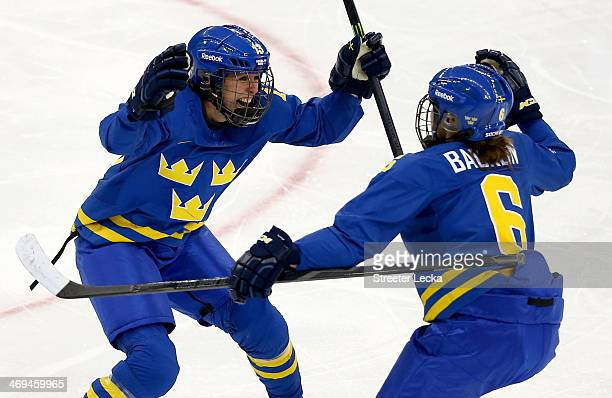 Lina Wester of Sweden celebrates with her teammate Lina Backlin after scoring a goal in the third period against Noora Raty of Finland during the...