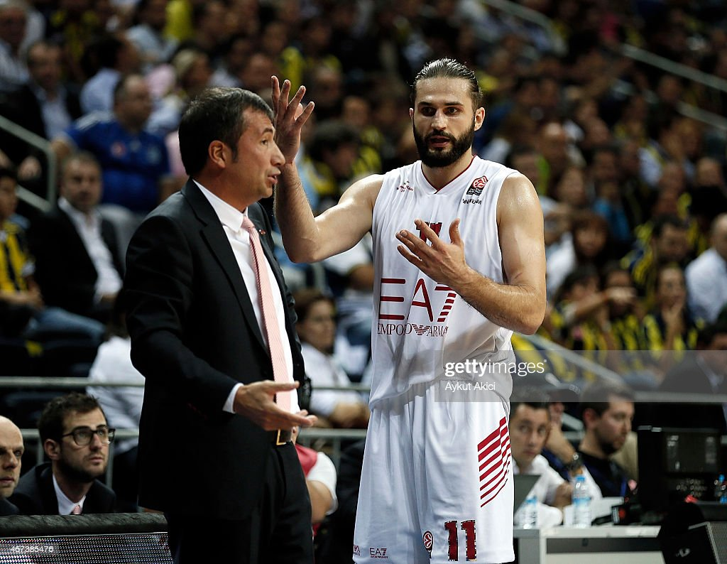 Linas Kleiza #11 of EA7 Emporio Armani Milan and Luca Banchi Head Coach of EA7 Emporio Armani Milan react during the 20142015 Turkish Airlines...