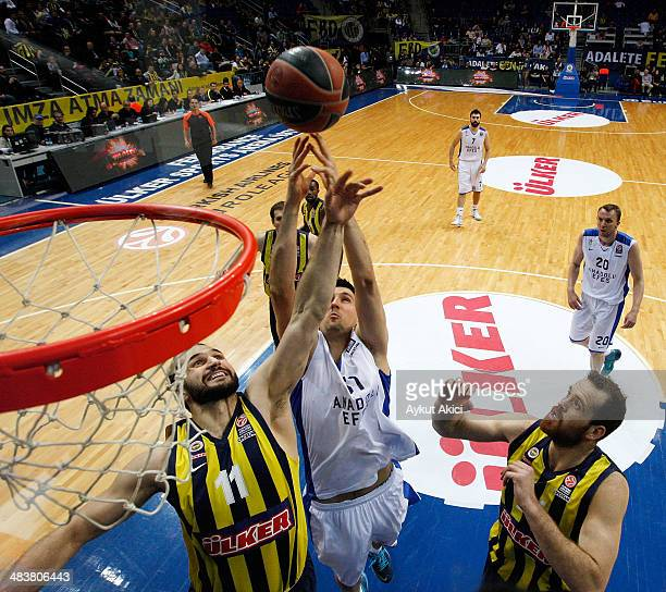 Linas Kleiza #11 of Fenerbahce Ulker Istanbul competes with Milko Bjelica #51 of Anadolu Efes Istanbul in action during the 20132014 Turkish Airlines...