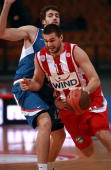 Linas Kleiza #11 of Olympiacos Piraeus competes with Luksa Andric #12 of KK Cibona Zagreb during the Euroleague Basketball 20092010 Last 16 Game 3...