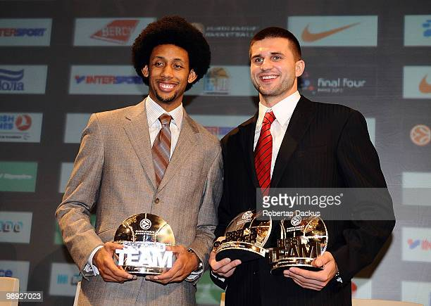 Linas Kleiza and Josh Childress pose with their awards during the Euroleague Basketball 20092010 Season Awards Ceremony at Hotel de Ville on May 8...