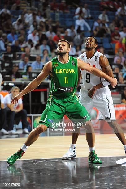 Linas Kleiza of Lithuania boxes out against Andre Iguodala of the USA Senior Men's National Team during the 2010 World Championships of Basketball on...