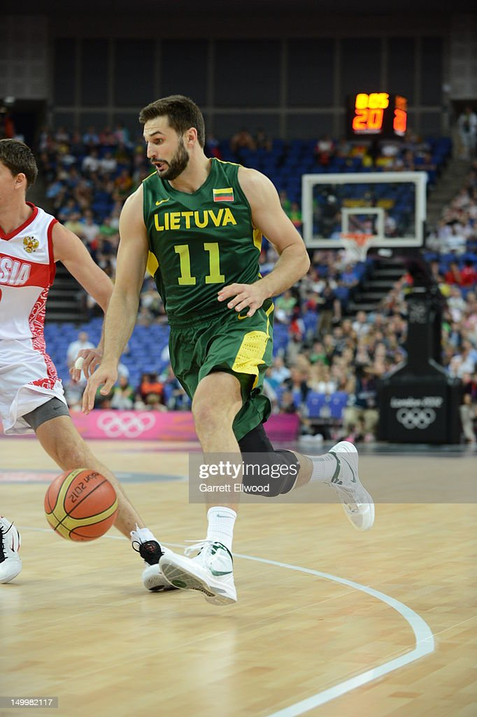 Linas Kleiza #11 of Lithuania dribbles against Russia during their Basketball Game on Day 12 of the London 2012 Olympic Games at the North Greenwich Arena on August 8, 2012 in London, England.