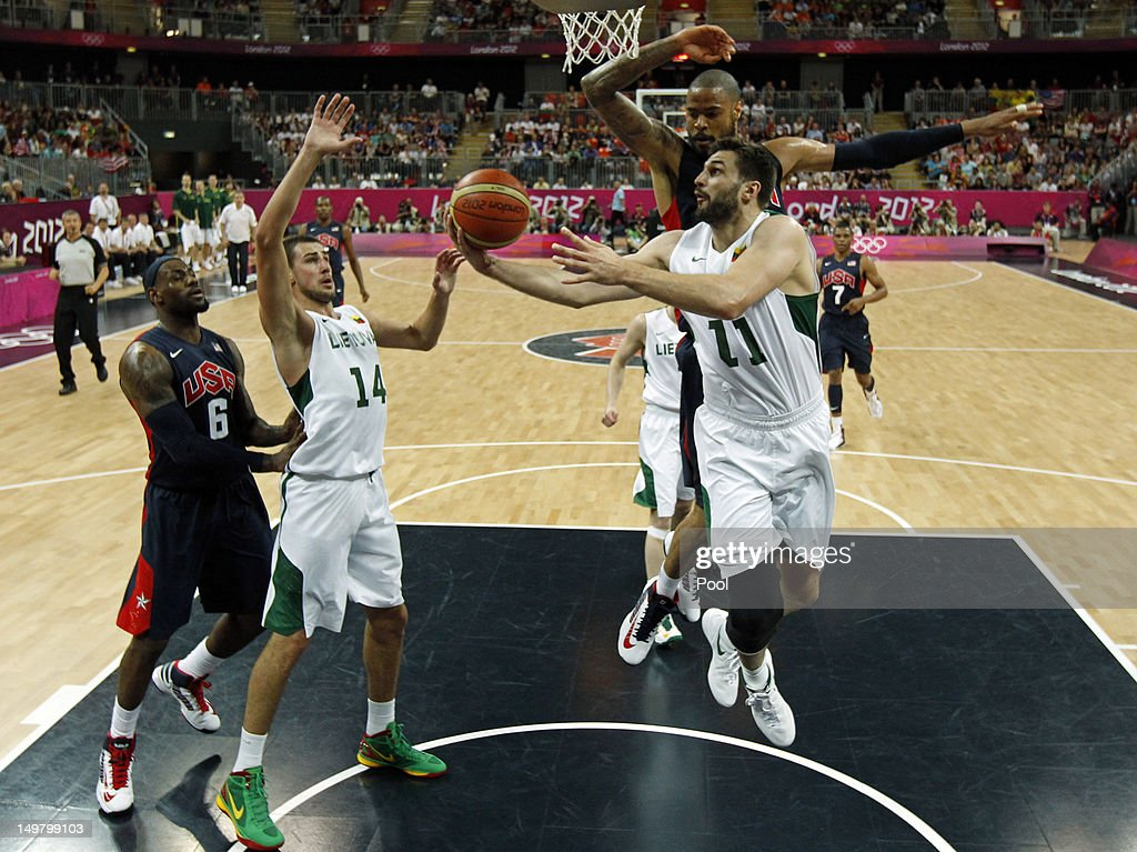 Linas Kleiza (R) of Lithuania goes past Tyson Chandler (rear) of the United States for a layup as teammate Jonas Valanciunas (2nd L) and Lebron James (L) looks on during the Men's Basketball Preliminary Round match between Lithuania and the United States on Day 8 of the London 2012 Olympic Games at Basketball Arena on August 4, 2012 in London, England.