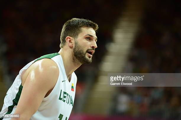 Linas Kleiza of Lithuania looks on against the United States during their Basketball Game on Day 8 of the London 2012 Olympic Games at the Olympic...