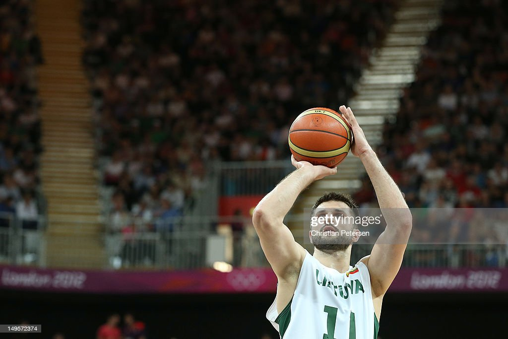 Linas Kleiza of Lithuania shoots a free throw in the Men's Basketball Preliminary Round match between Lithuania and Nigeria on Day 4 of the London...