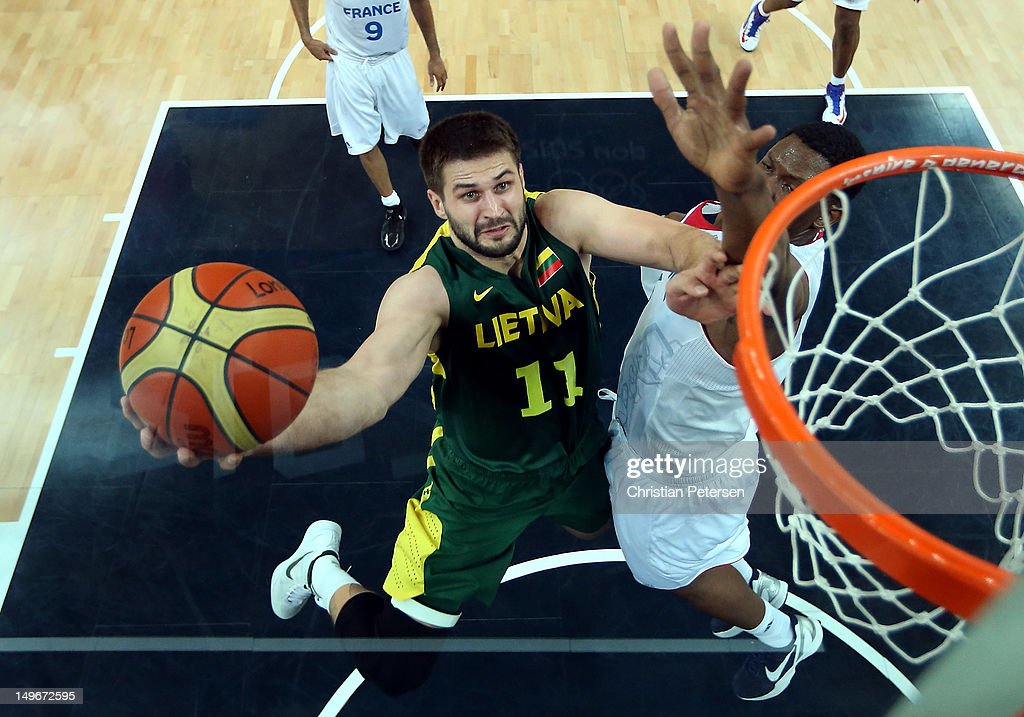 Linas Kleiza of Lithuania shoots against Kevin Seraphin of France during the Men's Basketball Preliminary Round match on Day 6 of the London 2012...
