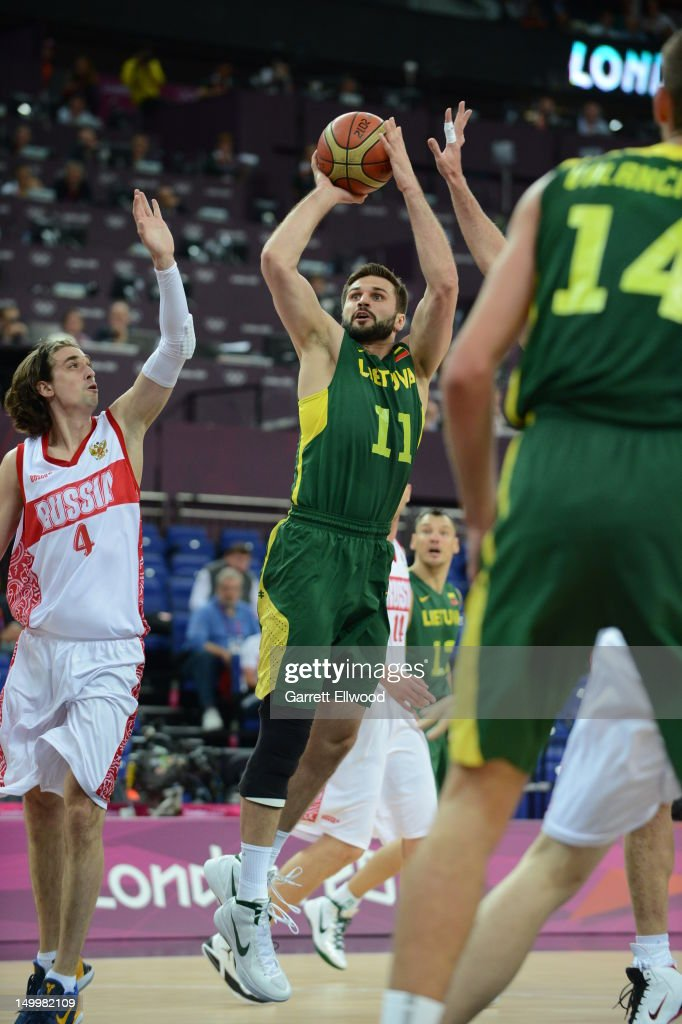 Linas Kleiza #11 of Lithuania shoots against Russia during their Basketball Game on Day 12 of the London 2012 Olympic Games at the North Greenwich Arena on August 8, 2012 in London, England.
