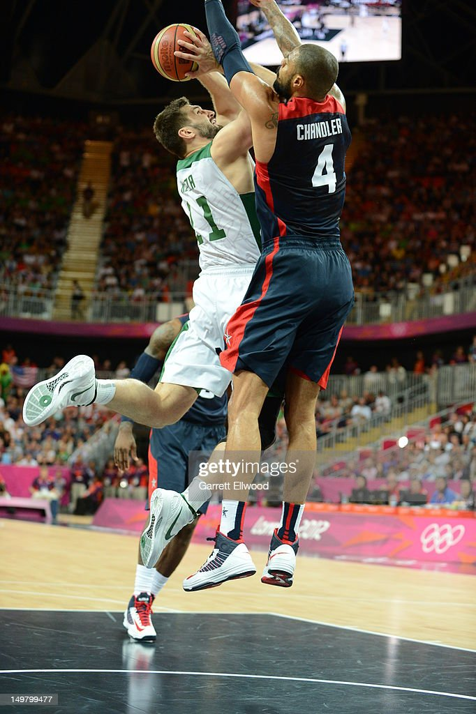 Linas Kleiza #11 of Lithuania shoots against Tyson Chandler #4 of the United States during their Basketball Game on Day 8 of the London 2012 Olympic Games at the Olympic Park Basketball Arena on August 4, 2012 in London, England.