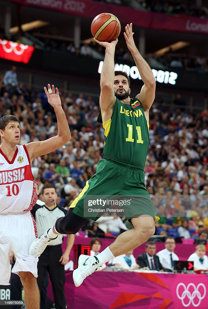 Linas Kleiza #11 of Lithuania shoots the ball in front of Victor Khryapa #10 of Russia in the second half during the Men's Basketball quaterfinal game on Day 12 of the London 2012 Olympic Games at North Greenwich Arena on August 8, 2012 in London, England.