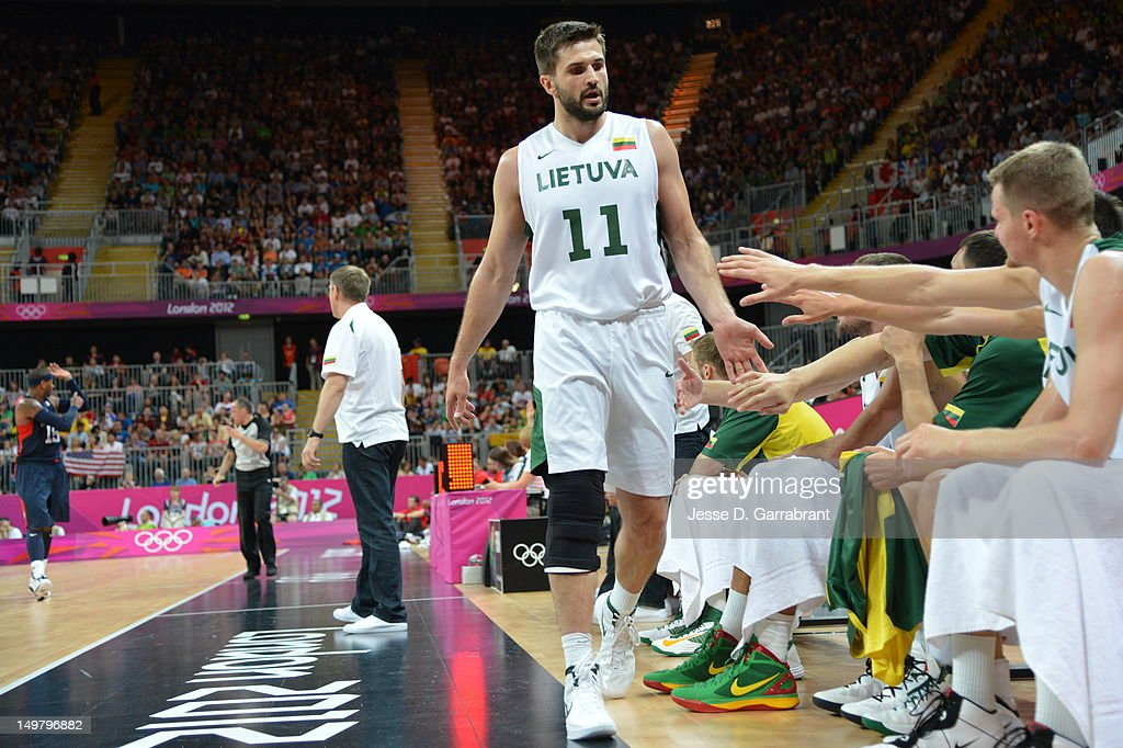 Linas Kleiza #11 of Lithuania walks to the bench against the United States during their Basketball Game on Day 6 of the London 2012 Olympic Games at the Olympic Park Basketball Arena on August 4, 2012 in London, England.
