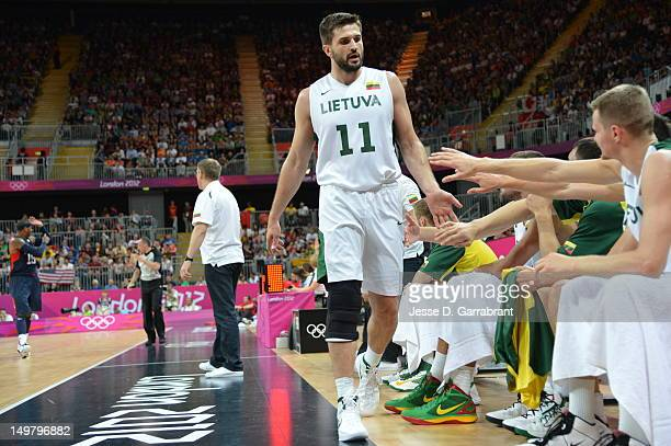 Linas Kleiza of Lithuania walks to the bench against the United States during their Basketball Game on Day 6 of the London 2012 Olympic Games at the...