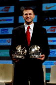 Linas Kleiza of Olympiacos poses with his Alphonso Ford Top Scorer and Best First Team trophies during the Euroleague Basketball 20092010 Season...