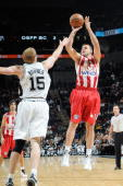 Linas Kleiza of the Greece Olympiacos shoots a jumper against Matt Bonner of the San Antonio Spurs during the exhibition game on October 9 2009 at...