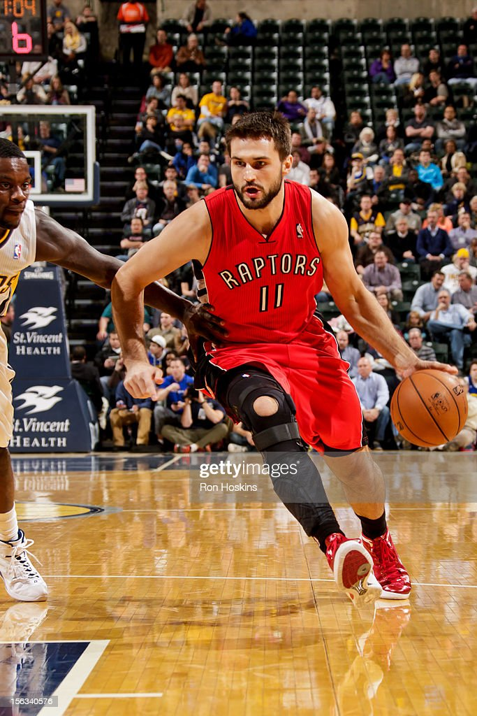 Linas Kleiza #11 of the Toronto Raptors drives against the Indiana Pacers on November 13, 2012 at Bankers Life Fieldhouse in Indianapolis, Indiana.