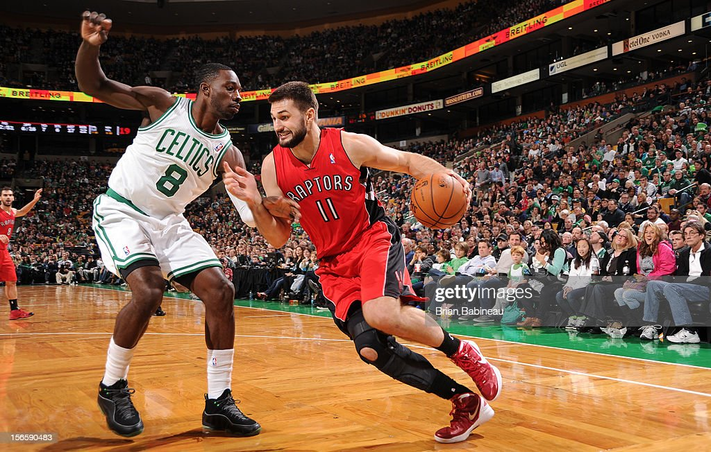 Linas Kleiza #11 of the Toronto Raptors drives to the basket against Jeff Green #8 of the Boston Celtics on November 17, 2012 at the TD Garden in Boston, Massachusetts.