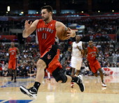 Linas Kleiza of the Toronto Raptors drives to the basket during a 10283 Los Angeles Clipper win at Staples Center on December 9 2012 in Los Angeles...