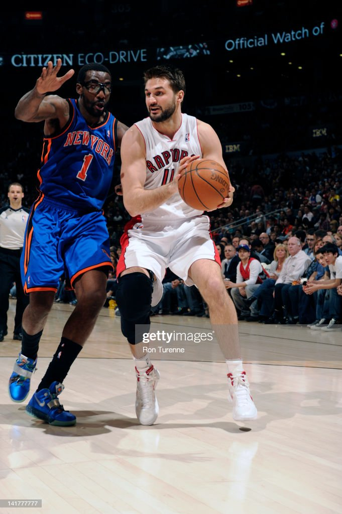Linas Kleiza of the Toronto Raptors looks to drive against Amare Stoudemire of the New York Knicks on March 23 2012 at the Air Canada Centre in...