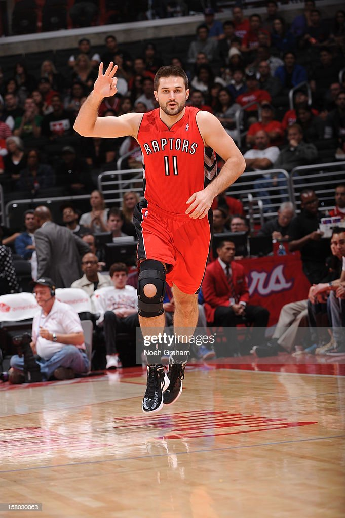 <a gi-track='captionPersonalityLinkClicked' href=/galleries/search?phrase=Linas+Kleiza&family=editorial&specificpeople=211014 ng-click='$event.stopPropagation()'>Linas Kleiza</a> #11 of the Toronto Raptors reacts after making a shot against the Los Angeles Clippers at Staples Center on December 9, 2012 in Los Angeles, California.