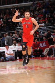 Linas Kleiza of the Toronto Raptors reacts after making a shot against the Los Angeles Clippers at Staples Center on December 9 2012 in Los Angeles...