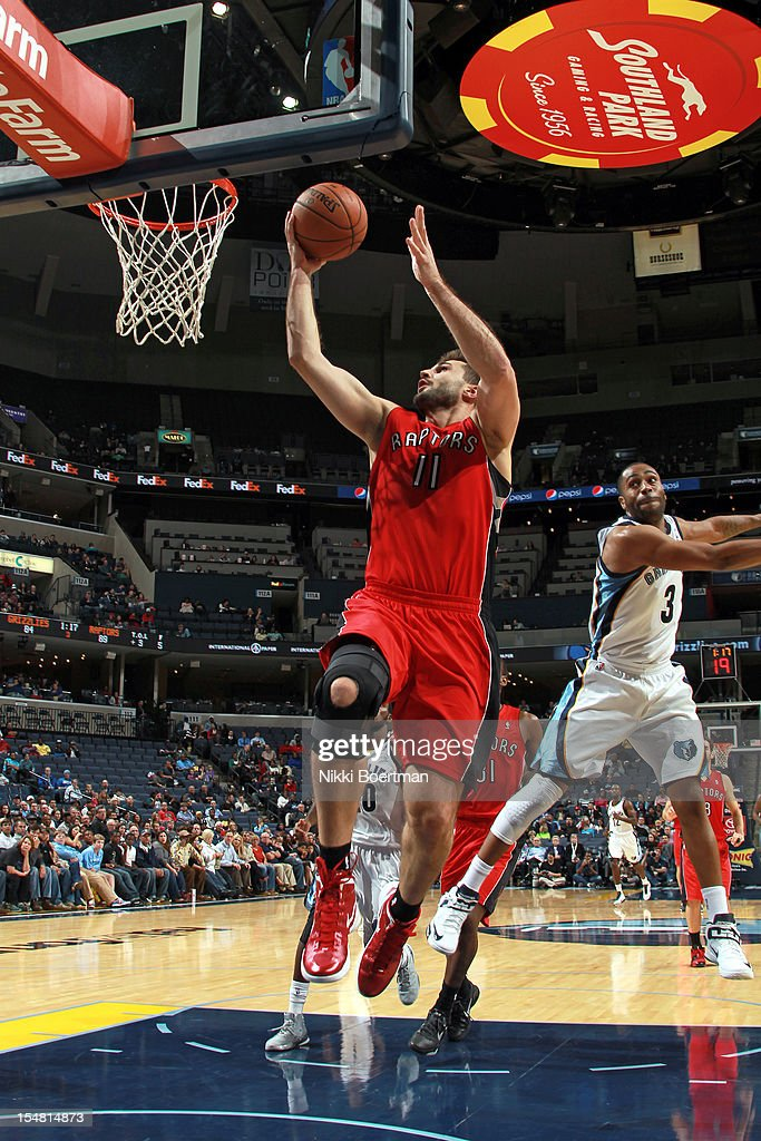Linas Kleiza #11 of the Toronto Raptors shoots a layup against the Memphis Grizzlies on October 26, 2012 at FedExForum in Memphis, Tennessee.