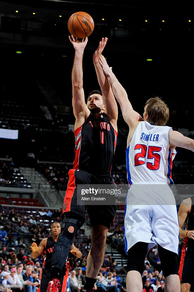 Linas Kleiza #11 of the Toronto Raptors shoots against Kyle Singler #25 of the Detroit Pistons on November 23, 2012 at The Palace of Auburn Hills in Auburn Hills, Michigan.