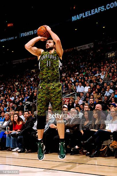 Linas Kleiza of the Toronto Raptors shoots against the Orlando Magic on March 26 2012 at the Air Canada Centre in Toronto Ontario Canada NOTE TO USER...