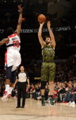 Linas Kleiza of the Toronto Raptors takes a jump shot over Cartier Martin of the Washington Wizards during the game on April 1 2012 at the Air Canada...