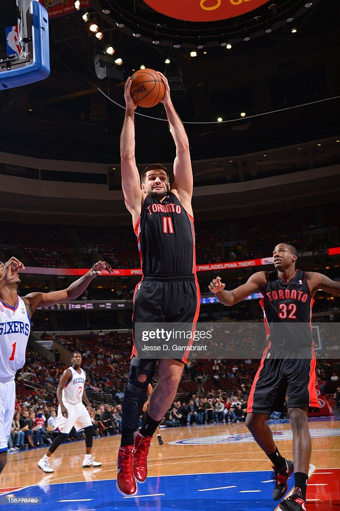 Linas Kleiza #11 of the Toronto Raptors takes down a rebound against the Philadelphia 76ers during the game at the Wells Fargo Center on November 20, 2012 in Philadelphia, Pennsylvania.