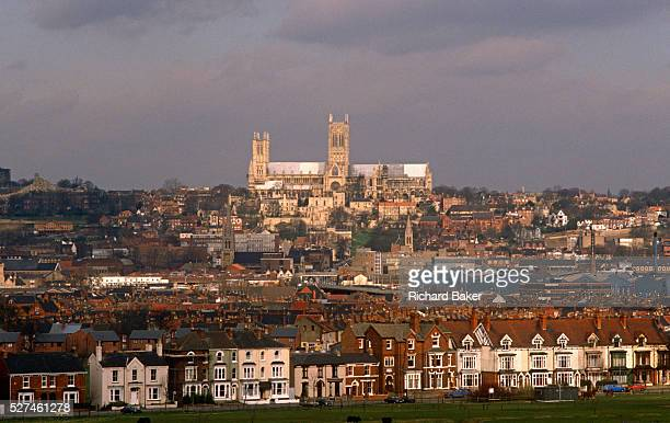 Lincoln Cathedral sits high on the skyline across the city from terraced housing In the distance the cathedral stands dominating the city Building...
