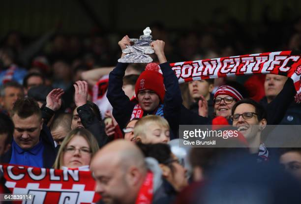 Lincoln City fans celebrate after The Emirates FA Cup Fifth Round match between Burnley and Lincoln City at Turf Moor on February 18 2017 in Burnley...