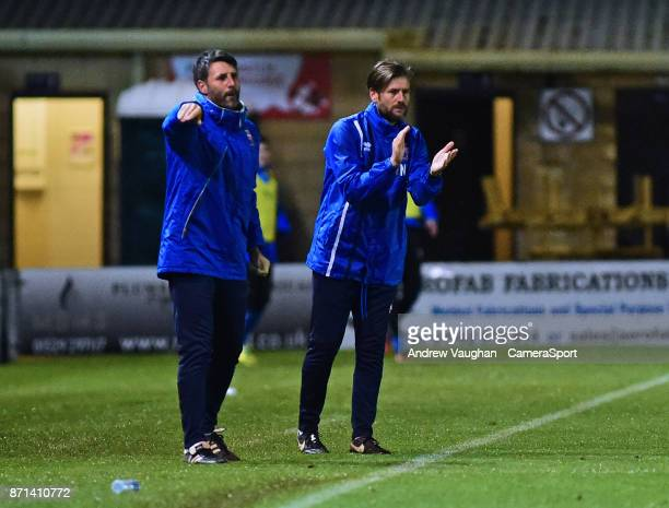 Lincoln City manager Danny Cowley and Lincoln City's assistant manager Nicky Cowley shout instructions to their team from the technical area during...