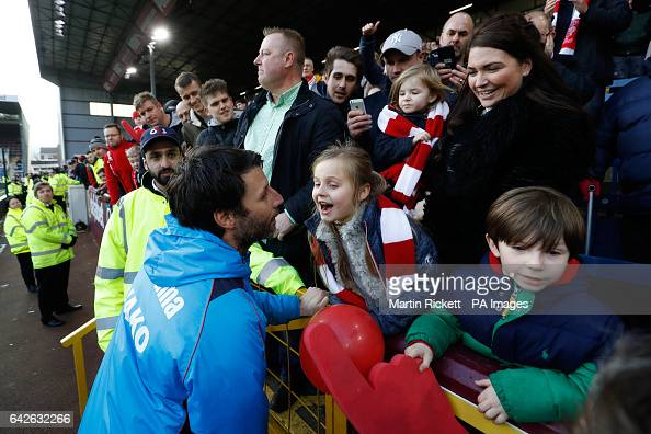 Lincoln City Manager Danny Cowley celebrates with his daughter Isabella after the final whistle of the Emirates FA Cup Fifth Round match at Turf Moor...