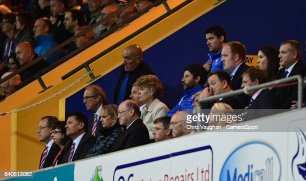 Lincoln City manager Danny Cowley centre watches the second half from the directors box after being sent to the stand by referee David Webb during...