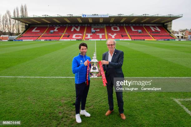 Lincoln City manager Danny Cowley left and Lincoln City chairman Bob Dorrian pose for a photograph with the Emirates FA Cup during the Lincoln City...
