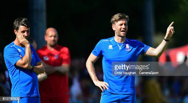 Lincoln City manager Danny Cowley left and Lincoln City's assistant manager Nicky Cowley shouts instructions to his team from the technical area...