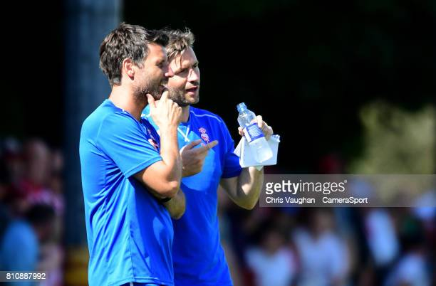 Lincoln City manager Danny Cowley left and Lincoln City's assistant manager Nicky Cowley during the preseason friendly match between Lincoln United...