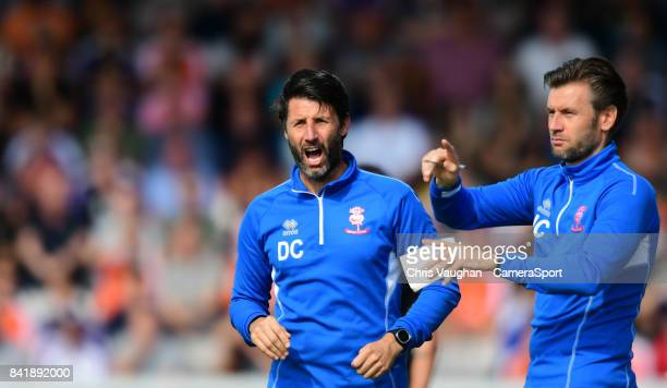 Lincoln City manager Danny Cowley left and Lincoln City's assistant manager Nicky Cowley shout instructions to their team from the technical area...