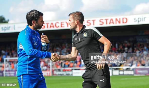 Lincoln City manager Danny Cowley left shakes hands with Luton Town manager Nathan Jones before kick off during the Sky Bet League Two match between...