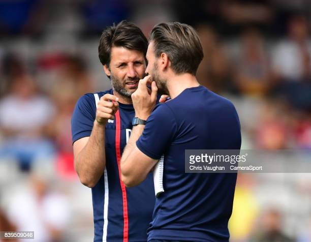 Lincoln City manager Danny Cowley left speaks to Lincoln City's assistant manager Nicky Cowley during the Sky Bet League Two match between Lincoln...