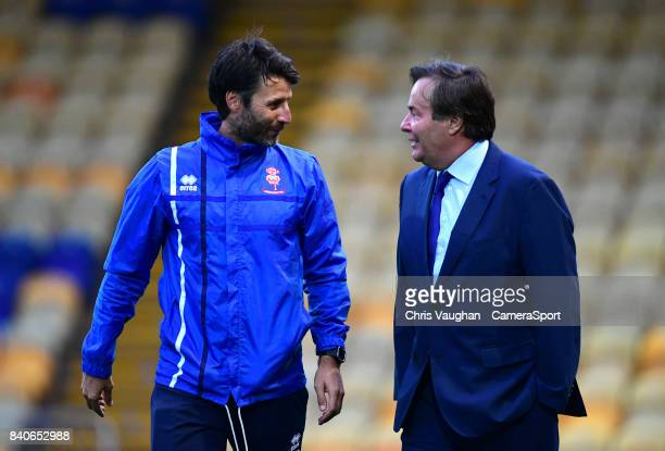 Lincoln City manager Danny Cowley left speaks to Mansfield Town chairman John Radford prior to the EFL Checkatrade Trophy Northern Section Group G...