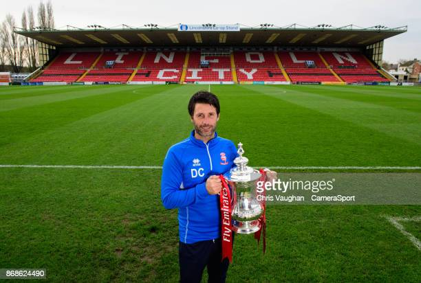 Lincoln City manager Danny Cowley poses for a photograph with the Emirates FA Cup during the Lincoln City FA Cup First Round Media Press Conference...