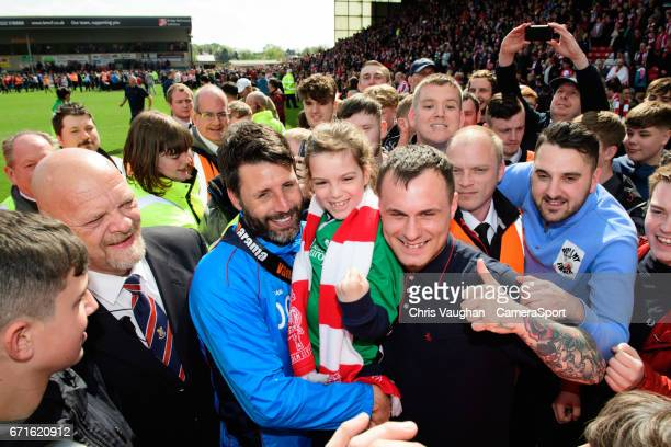 Lincoln City manager Danny Cowley poses for photographs with fans during a lap of honour after the Vanarama National League match between Lincoln...