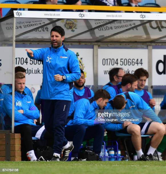 Lincoln City manager Danny Cowley shouts instructions to his team from the dugout during the Vanarama National League match between Southport and...