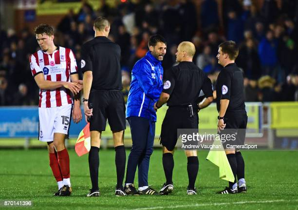 Lincoln City manager Danny Cowley speaks to Referee Andy Woolmer following the Emirates FA Cup First Round match between AFC Wimbledon and Lincoln...
