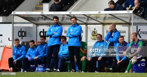 Lincoln City manager Danny Cowley stood left and Lincoln City's assistant manager Nicky Cowley stood right watch on from the dugout during the...