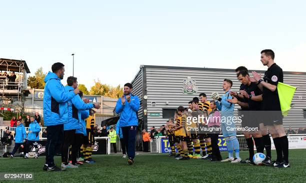 Lincoln City manager Danny Cowley walks through a guard of honour formed by the Maidstone United players prior to the Vanarama National League match...