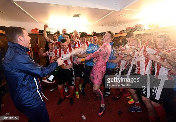 Lincoln City players celebrate their win in the changing room after the Emirates FA Cup Fourth Round match between Lincoln City and Brighton and Hove...